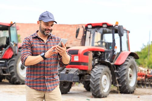 Man on social media by a tractor